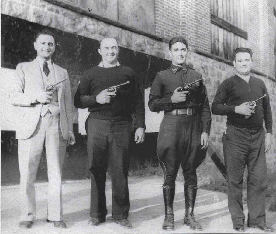 "Joseph Navatto Jr., Andrew ""BabEy the Cop"" Babey (patrolman), Ralph ""Johnson The Cop"" Petrone, and Lorenzo ""Renzi"" Rossi (chief of police)"