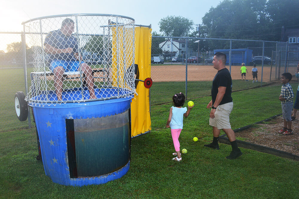 Officer in dunk tank with community members